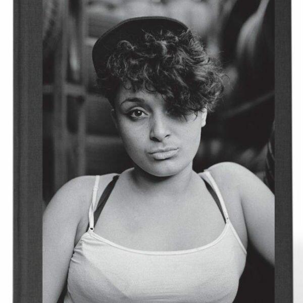 (Book cover image) Bella Santiago Rodriguez, aspiring auto shop worker. @ Edwin Torres/Bronx Photo League